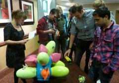 Students examine the 'Tree fo Knowledge, featured on Dragons' Den