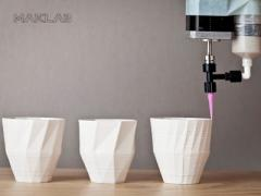 3D printer creating cup protoypes