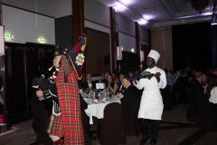 Pipe Major Iain Grant piping out after addressing the haggis.