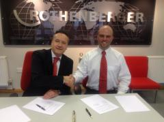 Ross Dickinson signing the agreement with Rothenberger