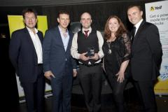 Ross Dickinson (centre) receiving his award at THe Pitch, with judges and MD of Yell.com