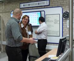 Chris Clark, Manufacturing Manager at Rosti UK, explainingthe real time monitoring system to Dr Gudrun Janke, Carron Phoenix Ltd